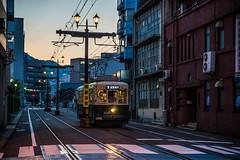 Tram 3 (kmmanaka) Tags: japan nagasaki evening harbor tram dejima meganebashi scooter