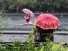 The Joy of Rain (CVerwaal) Tags: centralpark sailboatpond umbrellas newyork ny usa nyc rain olympusem5 lumixgvario1235f28 decisivemoment
