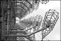Duga-3 a.k.a. 'Russian Woodpecker' (Bert Kaufmann) Tags: kyivoblast duga3 duga doega3 doega woodpecker pripyat  pripjat prypyat abandoned urbex verlaten desolaat ukraine oekrane kyiv oblast chernobyl chornobyl tsjernobyl disaster nucleardisaster kernramp chernobyldisaster nuclear exclusionzone chernobylnuclearpowerplant urbexing krasnoye   chernobylnuclearpowerplantzoneofalienation zoneofalienation giantantenna antenna antenne missiledetectionsystem russianwoodpecker therussianwoodpecker shortwave 10hz amateurradio zagorizontnajaradiolokatsionnajastantsiadoega   bw blackwhite zwartwit radar radarsysteem othradar