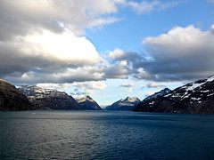 photo - entering Prince Kristian Fjord, Greenland (Jassy-50) Tags: photo princekristianfjord princekristiansound fjord water mountains snow regentsevenseasvoyager sevenseasvoyager voyager cruiseship rssc greenland clouds