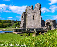 peering over the mounds at Ogmore (mr_mattelias) Tags: bridge brick green castle history grass rock stone southwales wales nikon ruins arch crossing path culture rocky walkway frame pathway ogmore bridgend ogmorecastle