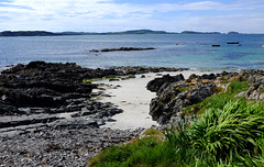 Beach at the Bottom of the Garden.... (wivvy is getting there.) Tags: x100s beach sand sea holidays scotland iona bishopshouse grass clouds bluesea rocks