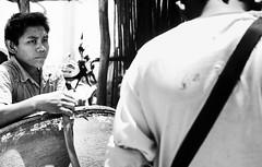 Pumping gas (sanyok_) Tags: boys portrol gasolina gas childlabor documentary photography street blackandwhite work southamerica