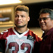 Tyrann Mathieu with attendee