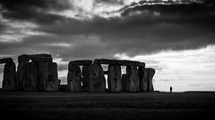 Stonehenge - Amesbury, United Kingdom - Black and white street photography (Giuseppe Milo (www.pixael.com)) Tags: fuji35 fuji3514 unitedkingdom street city greatbritain salisbury contrast monochrome uk photography fuji bw geotagged white streetphotography fujix sunset london neolithic mistery stonehenge amesbury alone archeology fujifilm light photo sun man urban fujixe2 candid blackandwhite black history clouds travel europe xe2 sky onsale england landscape