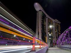 Marina Bay Sands Hotel, Singapore (monique_sg) Tags: marinabaysands hotel singapore slowshutter nightphotography architecture travel panasonic20mmf17 olympus epm2 lighttrails helixbridge cantilever cityscape nightscape nightshot longexposure colours traveldestination mirrorless