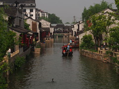 Keeping Up (tanxiaolian91) Tags: china river boat wuxi cormorant watertown dangkou