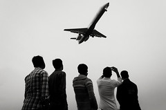 It's the ground where you can start flying... (_MaK_) Tags: street sky people bw monochrome plane flying candid brilliant bangladesh