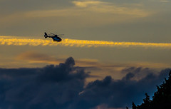 Going home . . (Eduard van Bergen) Tags: lost chopper helicopter light evening colors flying pilots cockpit propeller sony ilce alpha sigma art 60mm 28 dying day sun clouds roofs trees hovering night flight officer uniform police trooper state rotor test search party airplane departures arrivals homing home wind high chemtrail gendarmerie sky hemel himmel fire feu