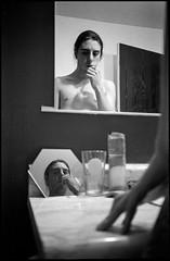 February 2016 (mkberquist) Tags: blackandwhite mirror hand mirrors rangefinder ilfordhp5 diafine hexagon hp5 toothbrush olympusxa mirrorportrait brushingteeth