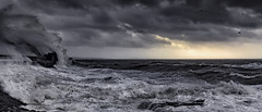 There is a lighthouse in there somewhere (MarkWaidson) Tags: sea lighthouse storm sunrise wave porthcawl