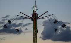 Airborne (tim.perdue) Tags: ohio state fair 2016 summer exposition center columbus street candid colorful multicolored midway carnival ride airborne sky clouds evening silhouette swings lights vertigo