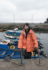 (Jeremy Hatcher) Tags: chile orange boats botes fisherman cigar pescador chiloe cigarro ancud naranjo