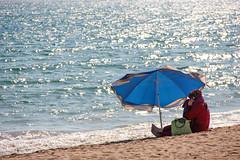 turkish muslim woman takes a call on the beach (Romeodesign) Tags: sea woman sun holiday beach mobile strand turkey coast mediterranean riviera phone muslim side urlaub türkiye cellular sunshade türkei antalya shore parasol peninsula turkish 550d pamphylian