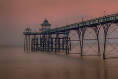 Waiting for the storm (Wizard CG) Tags: ocean blue sunset sea england sky orange seascape english heritage beach water skyline architecture river bristol landscape gold 1 coast amber pier seaside sand colorful waterfront outdoor piers united ngc kingdom arches grade severn shore historical channel listed clevedon cloudsstormssunsetssunrises epl7