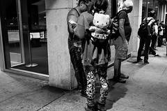 Hello, Kitty! (Culinary Fool) Tags: night 23mm belltown theater stranger people busstop blackwhite lowlight seattle backpack man wa culinaryfool woman august bw street 2016 washington brendajpederson