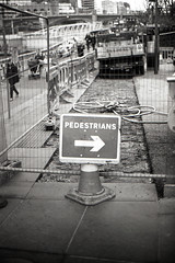 London (Jorkew) Tags: street uk bridge england people blackandwhite bw london saint st thames canon river lens paul 50mm cathedral suspension zwartwit kodak unitedkingdom ae1 britain tmax steel candid south united great bank kingdom pauls cable 11 50mm14 millennium millenniumbridge d76 waterloo cables developer program gb pedestrians british 100 stpaulscathedral canonae1 riverthames canonae1program bnw engeland bankside tmax100 londen 114 fd bwf rivier kodaktmax100 kodaktmax ae1program blackandwhitefilm canon50mm14 canon5014 londonmilleniumfootbridge kodakd76 kodakd7611 canonlensfd canonlensfd50mm114 kodakdeveloper powderdeveloper kodakblackandwhitefilm bwfp londonfootbridge