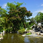 Water feature surrounded by trees in Muang Boran (Ancient Siam) in Samut Prakan, Thailand thumbnail