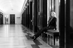 Lonesome Lady - pt. 2 (David Klumpp) Tags: davidklumpp schwarzweiss blackwhite blackandwhite portrait tbingen unitbingen frau blond blondine neueaula steinboden altesgebude bokeh drinnen gebude bank sitzen