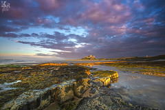Bamburgh Castle (Karl Ruston) Tags: water eeflections ocean coast northumberland bamburgh castle sky clouds outdoor landscape sunset sea cloud dusk mountain serene