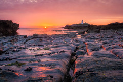 Look Before You Leap (Timothy Gilbert) Tags: lighthouse colours sunset godrevy panasonic ortoneffect boulders rocks hdr gwithian beach panasonic1235mmf28x nationaltrust sea orange coast wideangle cornwall gx7 clouds
