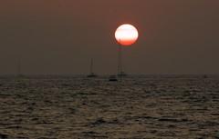 Sun sets in Santorini (somabiswas) Tags: santorini sunset sea mediterranean boat yatch caldera greece