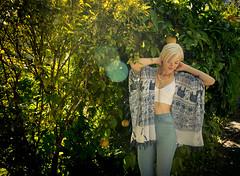 Beautiful girl in the sunlight (tibchris) Tags: trees portrait orange sunlight sexy green girl beautiful fashion outdoors model modeling jeans lensflare blonde catalog orangetree bustier bustiere snapchris 2bellacom