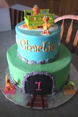 Dinosaur Train Birthday Cake (Grace-ful Cakes) Tags: cake train dinosaur traintracks tunnel birthdaycake fondant tiered tieredcake kidscake kidsbirthdaycake dinosaurtrain fondantrocks