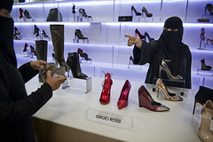 red slippers (Cloud Gate Blue) Tags: retail work women hijab workplace niqab riyadh saudiarabia womensrights
