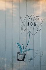 Hut 104 (Snappergus) Tags: flower art beach artistic number pot hut ornamental