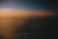 On Light & Loss (Kelly Marciano) Tags: blue light orange film clouds analog 35mm flying inflight glow dusk horizon fujifilm dreamy analogue canona1 vignette filmgrain sunest fujicolor superia200 fromawindow colornegativefilm