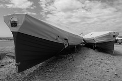Rock Gig (Richie Rue) Tags: blackandwhite monochrome outdoors mono boat gig shore aground rowingboat nikond300