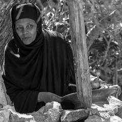 """""""And they said, We will call the damsel, and enquire at her mouth."""" (ybiberman) Tags: israel jerusalem oldcity alquds christianquarter deirelsultan woman people portrait nun ethiopian candid streetphotography bw veil peeping"""