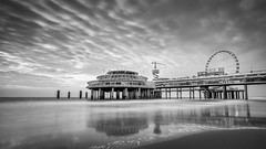 Scheveningen (miguel_lorente) Tags: blacknwhite longexposure blackandwhite dock netherlands scheveningen clouds holland bnw sea bw seascape depier coast city wheel