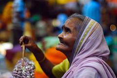Age no bar (Rajib Singha) Tags: street travel portrait people india flower interestingness searchthebest bokeh trade kolkata westbengal nikond200 mallikghatflowermarket mfnikkor50mmf14aislens