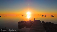 Sunset (Francesco Impellizzeri) Tags: sunset water reflections landscape boats ngc sicilia trapani