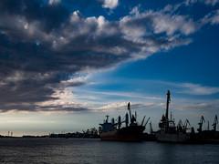 Klaipeda harbor - before the sun goes down (rainerralph) Tags: litauen olympus klaipeda memel europa lithuainia objektiv1240 harbor hafen omdem5markii europe harbour niemen