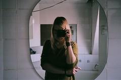in the bathroom (laumel) Tags: camera reflection film girl bathroom mirror minolta 200 vista plus agfa afc selfie cameraface juosta