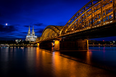 Oniric Cologne (Job I) Tags: world city travel bridge blue light moon classic church beauty architecture night reflections river germany landscape twilight europe cityscape cathedral dom steel gothic culture cologne kln artificial medieval hour dreams nrw colonia moonlight oniric rhine rhein rin