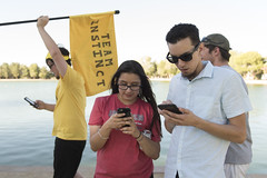 Pokemon Go gathering at Sunset Park (FreezeTimeDigital) Tags: game nikon lasvegas flag photojournalism smartphone d750 sunsetpark onassignment lasvegasreviewjournal teaminstinct pokemongo