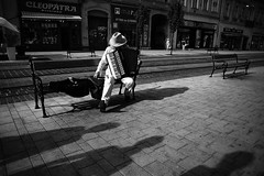 street music pause (Vadim Tsymbalyuk) Tags: miskolc borsodabajzempln hungary hu blackandwhite bw monochrome street sidewalk accordion accordionist musician music harmonist zuiko 24
