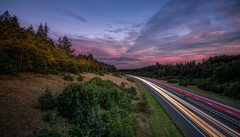 Almost home... (Lefers.) Tags: highway snelweg veluwe a1 sunset zonsondergang lighttrails lichtsporen lange sluitertijd compo composition photoshop lightroom natuur landscape nature verkeer traffic evening avond fuji xt1 fujinon 1024 mm assel hoenderloo apeldoorn wideangle groothoek file bomen trees clouds wolken