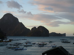 View over Bacuit Bay El Nido at sunset (omnia2070) Tags: philippines palawan el nido elnido bacuit bay sunset lassiette restaurant view cloud boat yacht bangka sea ocean limestone karst mountain landscape