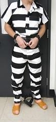 IMG_0785c (bob.laly) Tags: uniform chain jail shackles padlock handcuffs prisoner jumpsuit inmate
