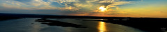 Panorama at the Oasis on Lake Travis (misscodyphotography) Tags: blue light sunset sky panorama orange sun lake reflection nature water clouds austin outside photography boat photo day texas tx country hill sunny oasis travis romantic jetski sunbeam atx bodyofwater