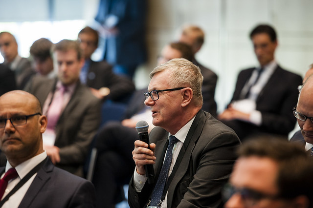 An attendee raising a question at the Siemens Side Event
