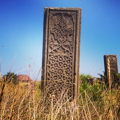 kyrhlyar.. (Zyama) Tags: yellow blue graveyard graves grass stone sky derbent daghestan