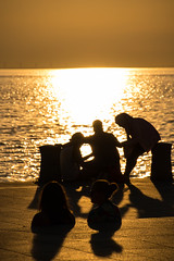 Sunset and silhouettes (Maria Eklind) Tags: sunlight sunset nature city vstrahamnen trdcket sun summer siluett malm boardwalk vatten sundspromenaden solnedgng goodnightsun silhouette europe sky sweden skneln sverige se