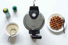 Waffles being made next to waffle maker (yourbestdigs) Tags: making cook closeup meal warm preparation kitchen delicious dessert maker sweet dough iron breakfast homemade wafer treat tasty belgian ladle bakery bake cake home confectionery prepare pour pastry golden waffle nutrition cooking food kitchenware raw