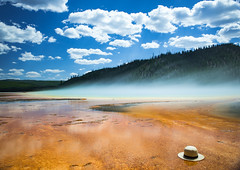 hold on to your hats (almostsummersky) Tags: geothermalpool midwaygeyserbasin pool hotspring nationalpark yellowstone thermophile steam grandprismaticspring hat summer bacterialmat travel longexposure clouds sky lost yellowstonenationalpark geothermal spring wyoming unitedstates us